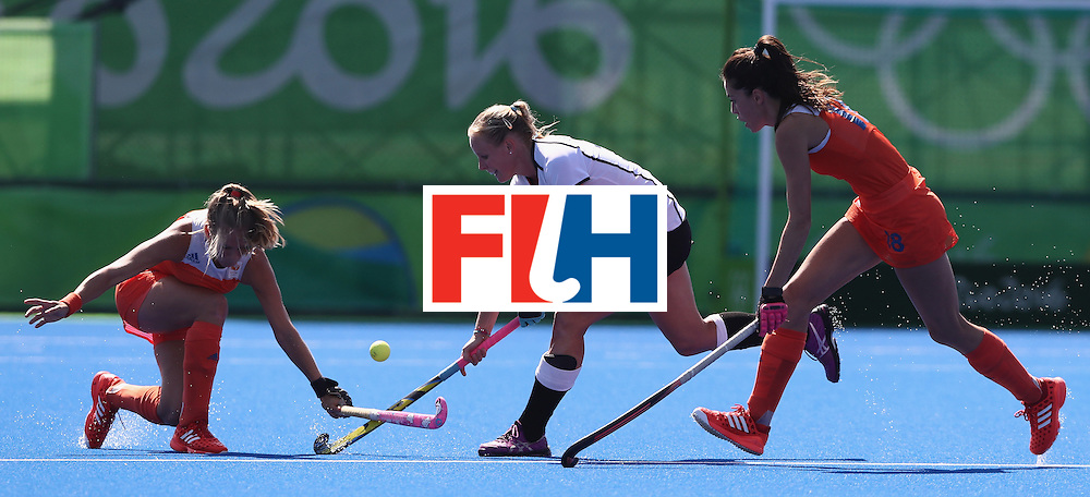 RIO DE JANEIRO, BRAZIL - AUGUST 13:  Hannah Kruger of Germany is tackled during the Women's group A hockey match between the Netherlands and Germany on Day 8 of the Rio 2016 Olympic Games at the Olympic Hockey Centre on August 13, 2016 in Rio de Janeiro, Brazil.  (Photo by David Rogers/Getty Images)