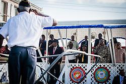 Gov de Jongh salutes parade Grand Marshall Albert A. Mercer.  Veteran's Day Parade and Program at the Frankliin Delano Roosevelt Memorial Park in Charlotte Amalie.  St. Thomas.  11 November 2013.  © Aisha-Zakiya Boyd