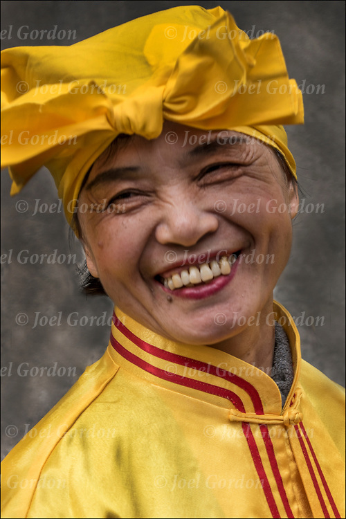 Portrait of smiling Chinese dancer before the start of  the 11th Annual Dance Parade to Tompkins Square Park NYC