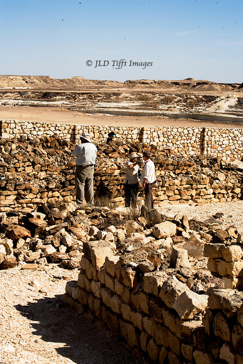 "Ruins of a trade warehouse near the vast Wadi Haynun, near the UNESCO ""Land of Frankincense"" preservation area, Dhofar, Oman.  The wall stumps are the remains of a stopover on the frankincense trade route through the Arabian peninsula."