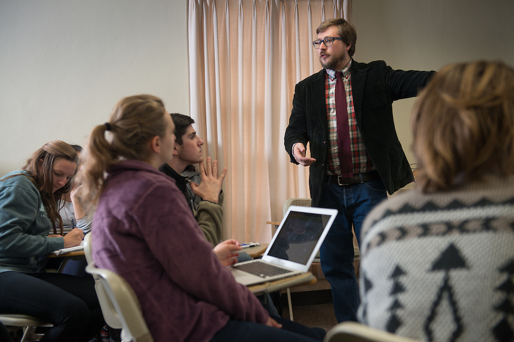 Brandon Kendhammer, Associate Professor in Ohio University's Department of Political Science, speaks with students during his politcal science course in Bentley Hall on Monday, November 14, 2016.