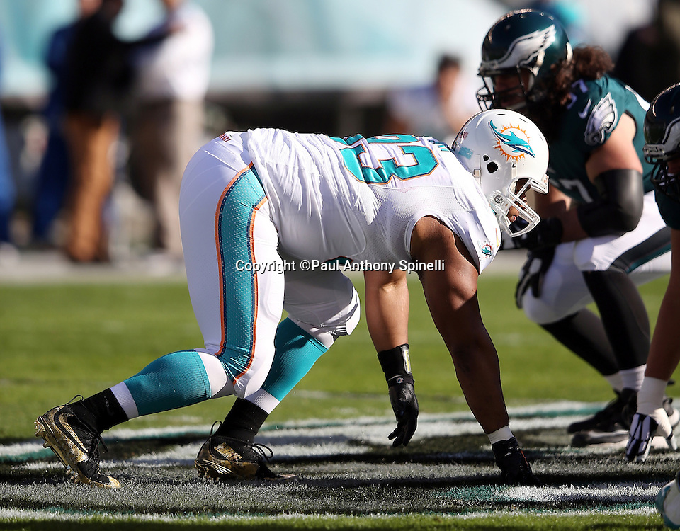 Miami Dolphins defensive tackle Ndamukong Suh (93) gets set for the snap in a four point stance during the 2015 week 10 regular season NFL football game against the Philadelphia Eagles on Sunday, Nov. 15, 2015 in Philadelphia. The Dolphins won the game 20-19. (©Paul Anthony Spinelli)