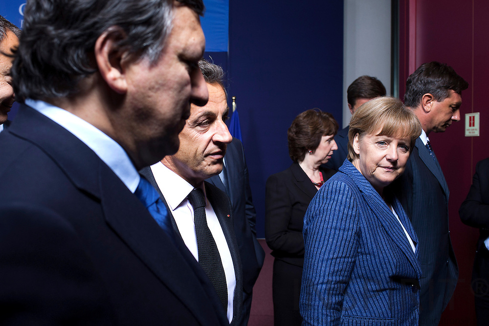 From left Jose Manuel Barroso, President for the European Commission, Nicolas Sarkozy, President of France, and The German Chancellor Angela Merkel after the family photo on the first day of the EU-Summit in Brussels 23 June 2011. PHOTO: ERIK LUNTANG / INSPIRIT Photo.
