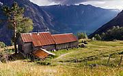 Kjeaasen (Kjeåsen) - a remote site at the bottom of Simadalsfjord in Eidfjord, Hordaland, western Norway. The farm house that is still in operation overlooks the fjord 530 meters below.