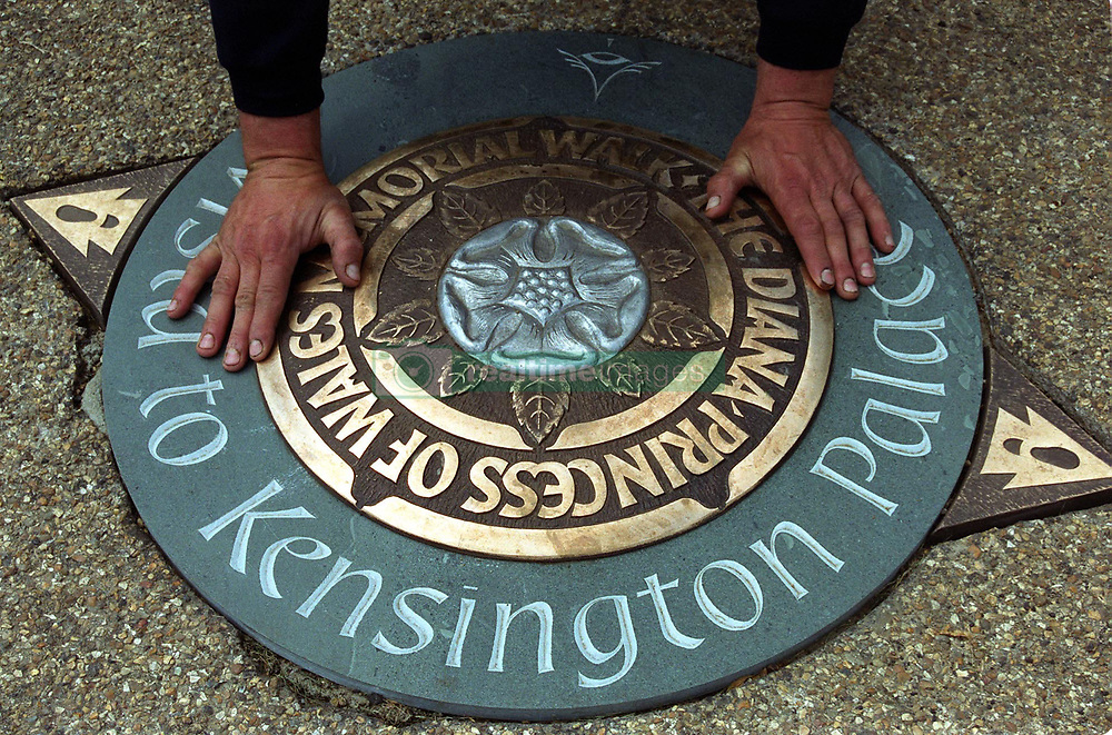 Terry Barton installs one of 80 commemorative Diana, Princess of Wales plaques which form a seven-mile walkway through four of London's parks.   * The plaques, commissioned by the Diana, Princess of Wales Memorial Committee are situated to view buildings associated with the Princess during her life, including Kensington Palace, where she lived for 15 years.