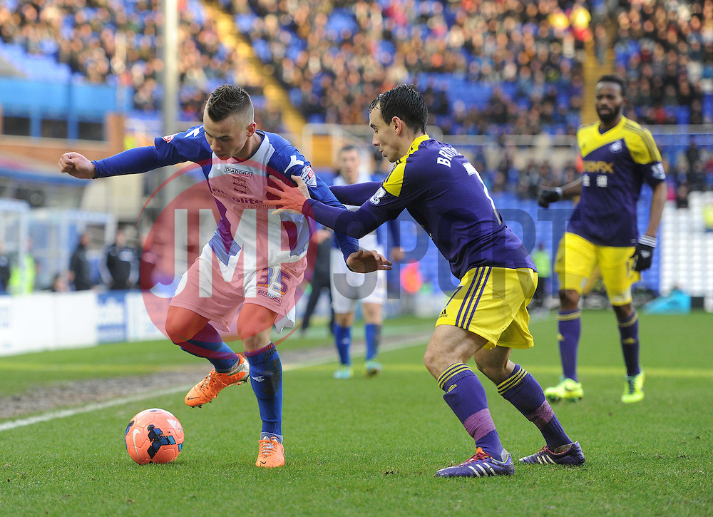 Birmingham City's Albert Rusnak shields Swansea City's Leon Britton from the ball. - Photo mandatory by-line: Alex James/JMP - Tel: Mobile: 07966 386802 25/01/2014 - SPORT - FOOTBALL - St Andrew's - Birmingham - Birmingham City v Swansea City - FA Cup - Forth Round