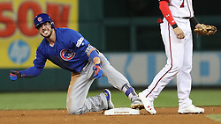 October 6, 2017 - Washington, DC, USA - The Chicago Cubs' Kris Bryant (17) celebrates his RBI single, with Washington Nationals shortstop Trea Turner at right, in the sixth inning during Game 1 of a National League Division Series on Friday, Oct. 6, 2017, at Nationals Park in Washington D.C. (Credit Image: © Brian Cassella/TNS via ZUMA Wire)