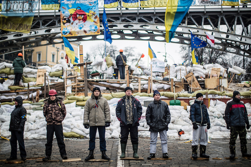 KIEV, UKRAINE - DECEMBER 13: Anti-government protesters guard a barricade designed to keep police from evicting them from Independence Square on December 13, 2013 in Kiev, Ukraine. Thousands of people have been protesting against the government since a decision by Ukrainian president Viktor Yanukovych to suspend a trade and partnership agreement with the European Union in favor of incentives from Russia. (Photo by Brendan Hoffman/Getty Images) *** Local Caption ***