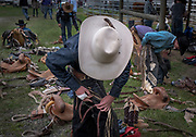 Cowboys prepare for rodeo competition at the 101st Falkland Stampede in Falkland, BC.     (2019)