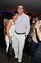 ANDREW MORTON and his wife CAROLYN at a party to celebrate the opening of the Rum Shack, Floridita, 100 Wardour Street, London on 1st February 2013.
