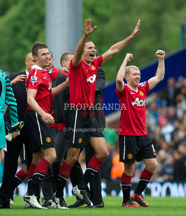 BLACKBURN, ENGLAND - Saturday, May 14, 2011: Manchester United's Rio Ferdinand celebrates winning the FA Premier League after his side scrapped a 1-1 draw with Blackburn Rovers during the Premiership match at Ewood Park. (Photo by David Rawcliffe/Propaganda)