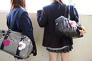 2 Japanese high school girls looking out of the window