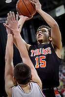 Post Falls High's Malcolm Colbert puts up a shot in front of a Madison High defender during Friday's game at the state 5A boys basketball tournament at the Idaho Center in Nampa.