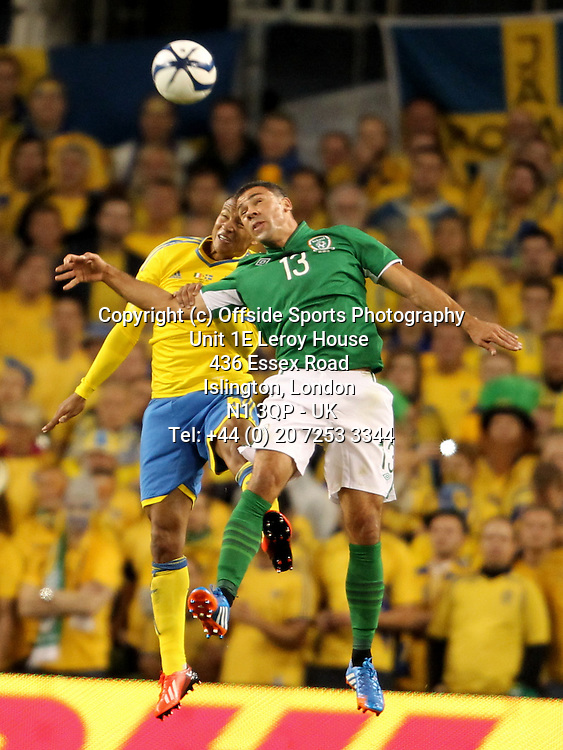 06/09/2013 FIFA 2014 World Cup Qualifying - Group C . Rep of Ireland v Sweden<br /> Martin Olsson and Jon Walters challenge for the ball<br /> Photo: John Halas
