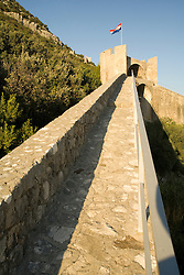 Europe, Croatia, Dalmatia, Mali Ston.  Walls of 15th century fort extend for over 3 miles, connecting towns of Ston and Mali Ston.