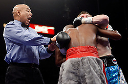 K.M. CANNON/REVIEW-JOURNALReferee Joe Cortez tries to break up Floyd Mayweather of Las Vegas, back to camera, and Ricky Hatton of Britain in the xxx round of their WBC World Welterweight Championship bout at the MGM Grand Garden Arena Saturday, Dec. 8, 2007. Mayweather won by knockout in the 10th round...