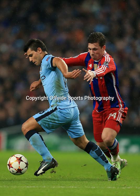 25th November 2014 - UEFA Champions League - Group E - Manchester City v Bayern Munich - Sergio Aguero of Man City battles with Pierre-Emile Hojbjerg of Bayern - Photo: Simon Stacpoole / Offside.