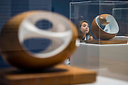 Pelagos 1946 (C) -Barbara Hepworth: Sculpture for a Modern World opens at Tate Britain -  the first London museum retrospective or five decades of the work of Hepworth (1903-75), one of Britain's greatest artists. This major retrospective opens on 24 June 2015 and will emphasise Hepworth's prominence in the international art world. It highlights the different contexts and spaces in which Hepworth presented her work, from the studio to the landscape. Highlights include: A room dedicated to a series of sculptures Hepworth carved in the 1940s, which are characterised by the dramatic hollowing out of pieces of wood and the painting of the interior spaces she opened up. Works in this room include the famous Pelagos 1946 ('sea' in Greek), which was inspired by a view of the bay of St Ives, Cornwall; Imposing wooden sculptures made from huge logs of the sumptuous tropical hardwood guarea, such as Corinthos 1954-5 – a grand 1 metre x 1 metre sculpture named after the ancient Greek city in which Hepworth summed up the light and landscape of Greece. The unusually large size of guarea pieces allowed Hepworth to experiment with interior spaces through the use of string, spiralling edges, paint or rough carved surfaces to maximise the effect of light; An architectural installation inspired by the Rietveld Pavilion, originally built at the Kröller-Müller Museum, Otterlo in 1965 which housed a display of Hepworth bronzes at its opening. The structure in the exhibition explores how Hepworth presented her works and how she worked on an international stage. Barbara Hepworth: Sculpture for a Modern World is at Tate Britain from 24 June to 25 October 2015.