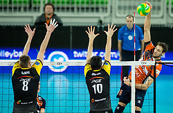 Jurii Gladyr of PGE Skra Belchatow and Nicolas Uriarte of PGE Skra Belchatow vs Jan Pokersnik of ACH during volleyball match between ACH Volley (SLO) and PGE Skra Belchatow (POL) in Round #4 of 2017 CEV Volleyball Champions League, on January 19, 2017 in Arena Stozice, Ljubljana, Slovenia. Photo by Vid Ponikvar / Sportida