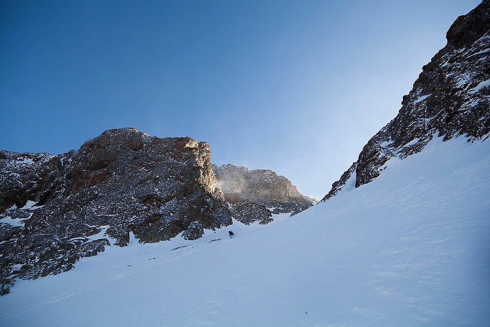 Sterling Roop skis down a couloir below Hayden Peak, San Juan Mountains, Colorado.