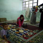August 11, 2012 - Azaz, Aleppo, Syria: A war refugee family display food in preparation for Ramadan break fast in a improvised refugee center in Azaz, where 32 families who fled the combat areas are temporarily living. (Paulo Nunes dos Santos)