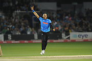 Tymal Mill celebrates the wicket of Andrew Salter the first wicket of his hat-trick during the Vitality T20 Blast South Group match between Sussex County Cricket Club and Glamorgan County Cricket Club at the 1st Central County Ground, Hove, United Kingdom on 14 August 2018.