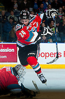 KELOWNA, CANADA - NOVEMBER 11: Tyson Baillie #24 jumps over Jackson Whistle #1 of Kelowna Rockets as he makes a save against the Vancouver Giants on November 11, 2015 at Prospera Place in Kelowna, British Columbia, Canada.  (Photo by Marissa Baecker/Shoot the Breeze)  *** Local Caption *** Tyson Baillie; Jackson Whistle;