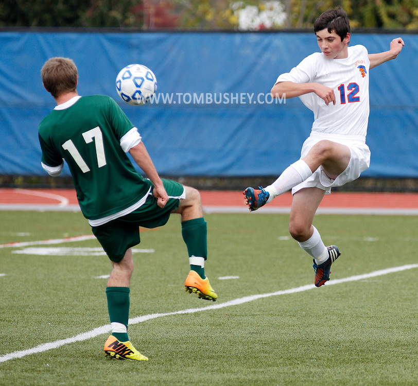 S.S. Seward's Jack Gardiner (12) kicks the ball past Webutuck's Sam Jaffe during the Section 9 Class C boys' soccer championship game at Faller Field in Middletown on Wednesday, Oct. 30, 2013.