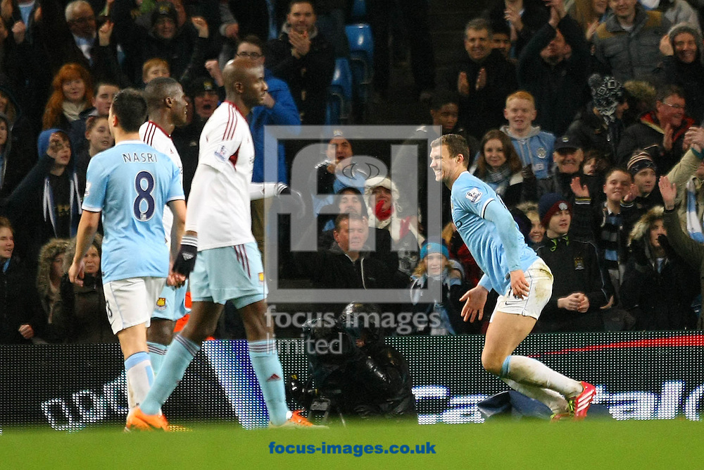 Picture by Paul Chesterton/Focus Images Ltd +44 7904 640267<br /> 08/01/2014<br /> Edin Džeko of Man City celebrates scoring his side's 5th goal during the Capital One Cup Semi Final 1st Leg match at the Etihad Stadium, Manchester.