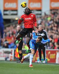 Cardiff City's Kenwyne Jones towers over Hull City's David Meyler to win a high ball. - Photo mandatory by-line: Alex James/JMP - Tel: Mobile: 07966 386802 22/02/2014 - SPORT - FOOTBALL - Cardiff - Cardiff City Stadium - Cardiff City v Hull City - Barclays Premier League