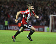 Brentford's Stuart Dallas scores the winner 2-1 during the Sky Bet Championship match between Brentford and Derby County at Griffin Park, London, England on 1 November 2014.