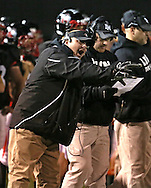Linn-Mar head coach Bob Forsyth yells to his players on the field during during the game between the Iowa City High Little Hawks and the Linn-Mar Lions at Linn-Mar Stadium in Marion on Friday October 12, 2012.
