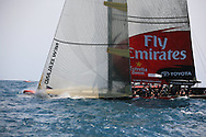 Emirates Team New Zealand speeds down leg of  America's Cup fleet race; Valencia, Spain.