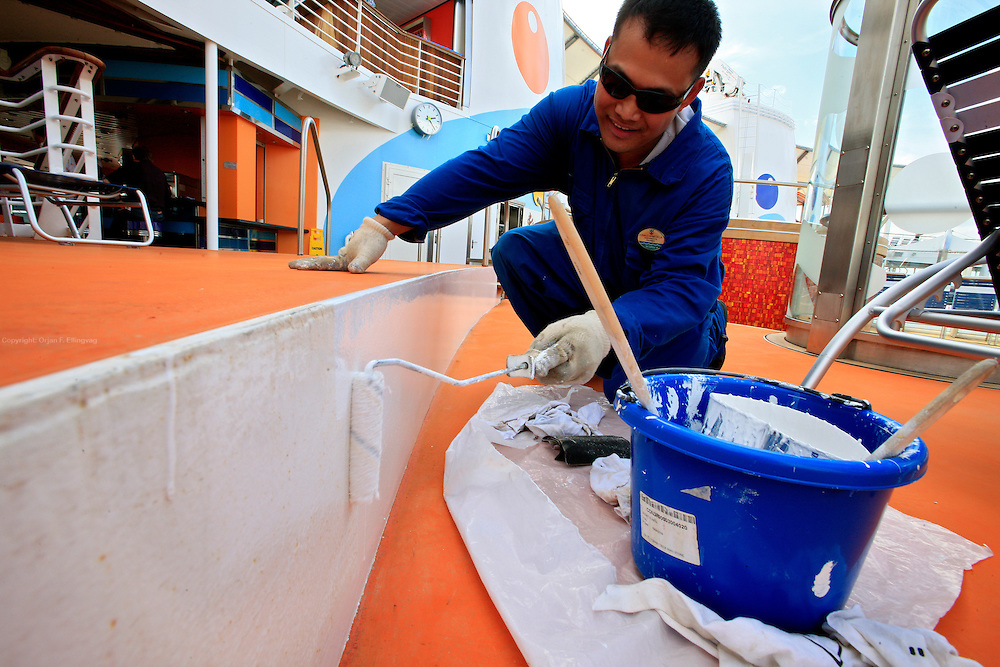 A crew member does some last minute paint job onboard the cruise ship Oasis of the Seas before her maiden voyage. The ship, currently the largest in the world, is owned by Royal Carribean Cruise Line.