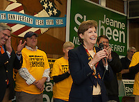 Senator Jeanne Shaheen speaks to the crowd gathered at the American Legion in Laconia supported by the Laconia Firefighters on Monday evening.  (Karen Bobotas/for the Laconia Daily Sun)