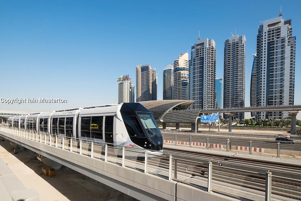 Tram on new Dubai Tram system in Marina district of Dubai United Arab Emirates