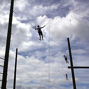 Participants tackle the course at  Rock'n'Ropes climbing course, Taupo, New Zealand,, 6th January 2010. Photo Tim Clayton