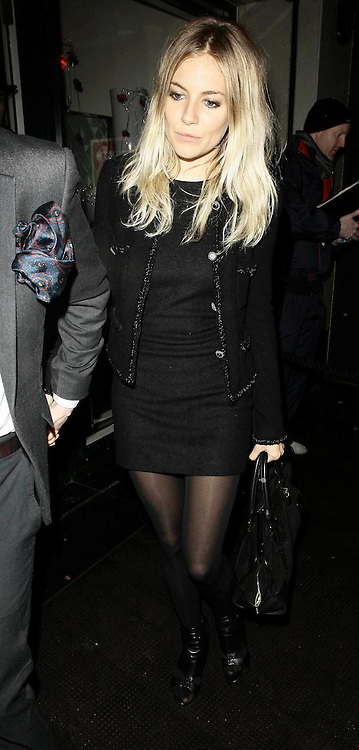 21.FEBUARY.2010 - LONDON<br /> <br /> SIENNA MILLER LEAVING THE IVY CLUB IN COVENT GARDEN AFTER ATTENDING THE AFTERPARTY FOR MATTHEW WILLIAMSON'S FASHION SHOW FOR LONDON FASHION WEEK.<br /> <br /> BYLINE: EDBIMAGEARCHIVE.COM<br /> <br /> *THIS IMAGE IS STRICTLY FOR UK NEWSPAPERS &amp; MAGAZINES ONLY*<br /> *FOR WORLDWIDE SALES &amp; WEB USE PLEASE CONTACT EDBIMAGEARCHIVE - 0208 954 5968*