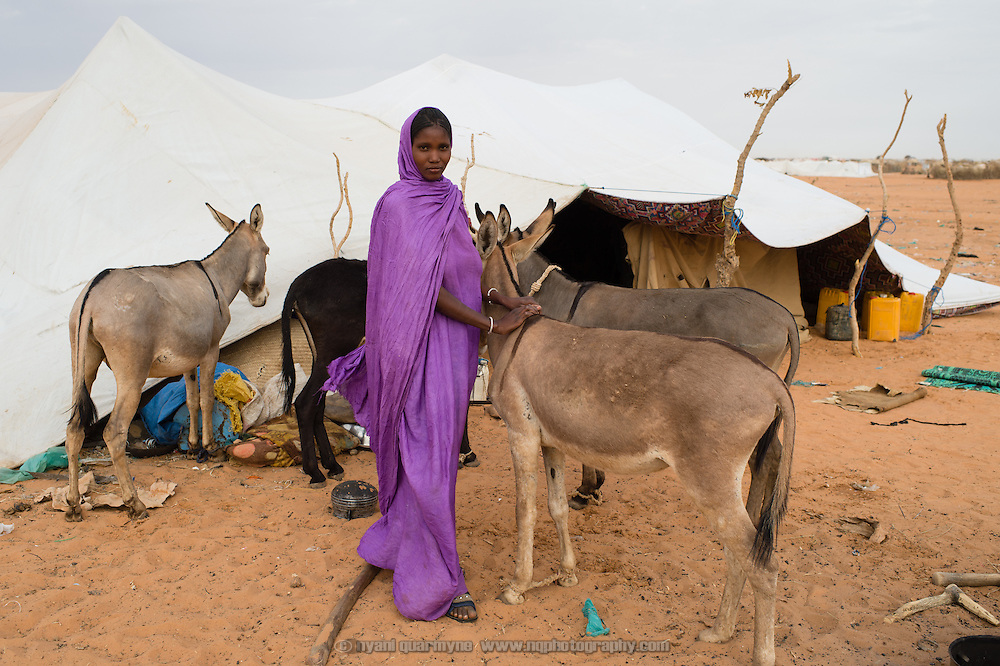 A woman outside her tent at at the Mbera camp for Malian refugees in Mauritania on 2 March 2013.