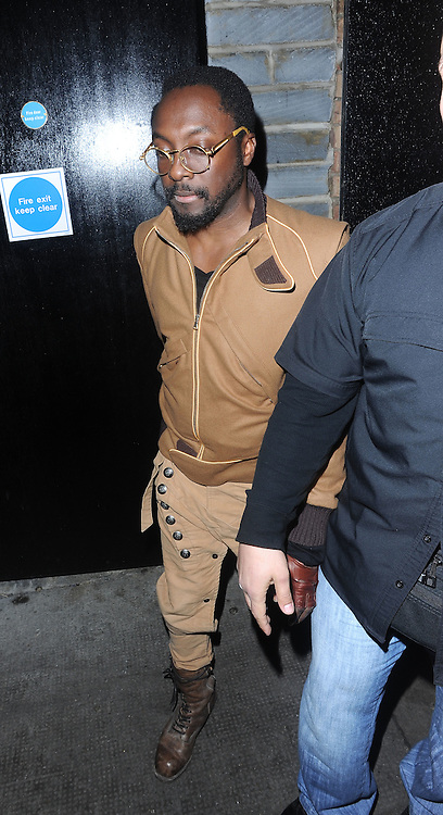 13.FEBRUARY.2012. LONDON<br /> <br /> WILL.I.AM LEAVING THE ROSE CLUB IN LONDON<br /> <br /> BYLINE: EDBIMAGEARCHIVE.COM<br /> <br /> *THIS IMAGE IS STRICTLY FOR UK NEWSPAPERS AND MAGAZINES ONLY*<br /> *FOR WORLD WIDE SALES AND WEB USE PLEASE CONTACT EDBIMAGEARCHIVE - 0208 954 5968*