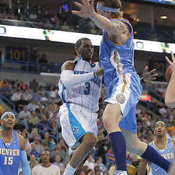 25 March 2009: New Orleans Hornets guard Chris Paul (3) passes the ball past Denver Nuggets center Chris Andersen (11) during a 101-88 loss by the New Orleans Hornets to the Denver Nuggets at the New Orleans Arena in New Orleans, Louisiana.