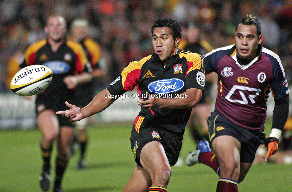 Chiefs fullback Mils Muliaina offloads the ball during the Super 14 match between the Waikato Chiefs and Queensland Reds at Waikato Stadium, Hamilton on Friday 3 March 2006. The Chiefs won the game 35:17. Photo: Andy Song/PHOTOSPORT
