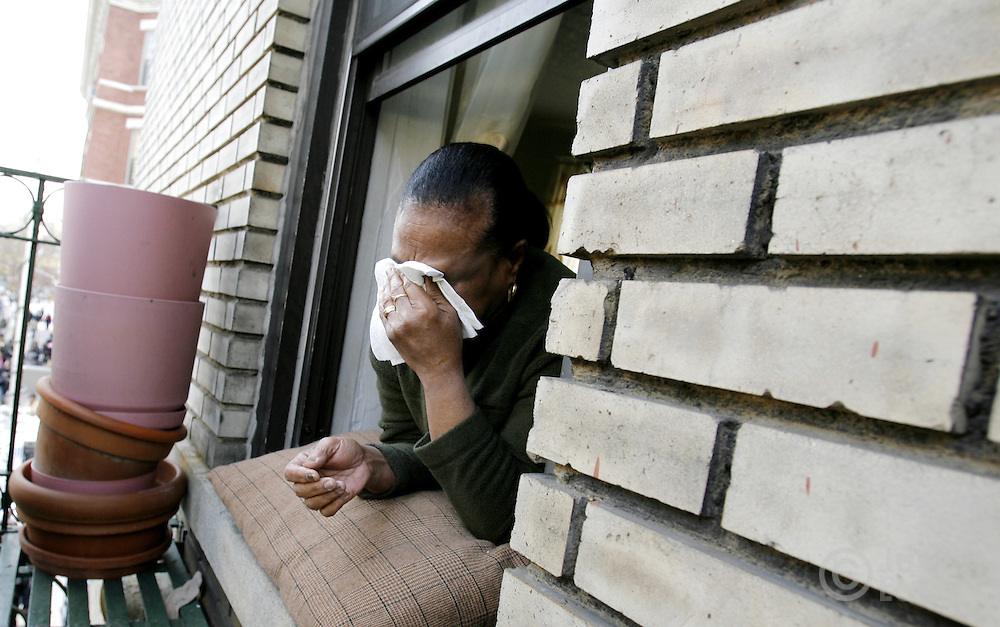 Maria Perez, of the Bronx, cries while watching the funeral services for the ten people killed in a recent house fire at the Islamic Cultural Center across the street in the Bronx, New York on Monday 12 March 2007. Of the ten people killed in the fire, 9 were children, and all were immigrants from Mali.