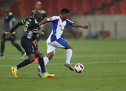 Sibusiso Msomi of Platinum Stars (L) and Buyani Sali of Chippa United during the 2016 Premier Soccer League match between Chippa United and Platinum Stars held at the Nelson Mandela Bay Stadium in Port Elizabeth, South Africa on the 28th October 2016<br />