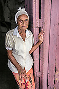 """Delsa Pena, 85, lives alone in a small dark apartment in Havana and spends her days walking around the city so that she doesn't feel too lonely. She has six children, 14 grandchildren, 16 great grandchildren and one great-great grandchild. """"The hardest experience in my life was when my husband fell in love with another woman and I had to leave him,"""" she says. """"I've always been unlucky in love,"""" she adds. Of Cuban women she says, """"we are beautiful loving and respectful. Before the revolution, we were domestic servants but now we have more rights and possibilities."""""""