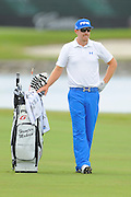 Hunter Mahan stands with his bag during the first round of the World Golf Championship Cadillac Championship on the TPC Blue Monster Course at Doral Golf Resort And Spa on March 8, 2012 in Doral, Fla. ..©2012 Scott A. Miller.