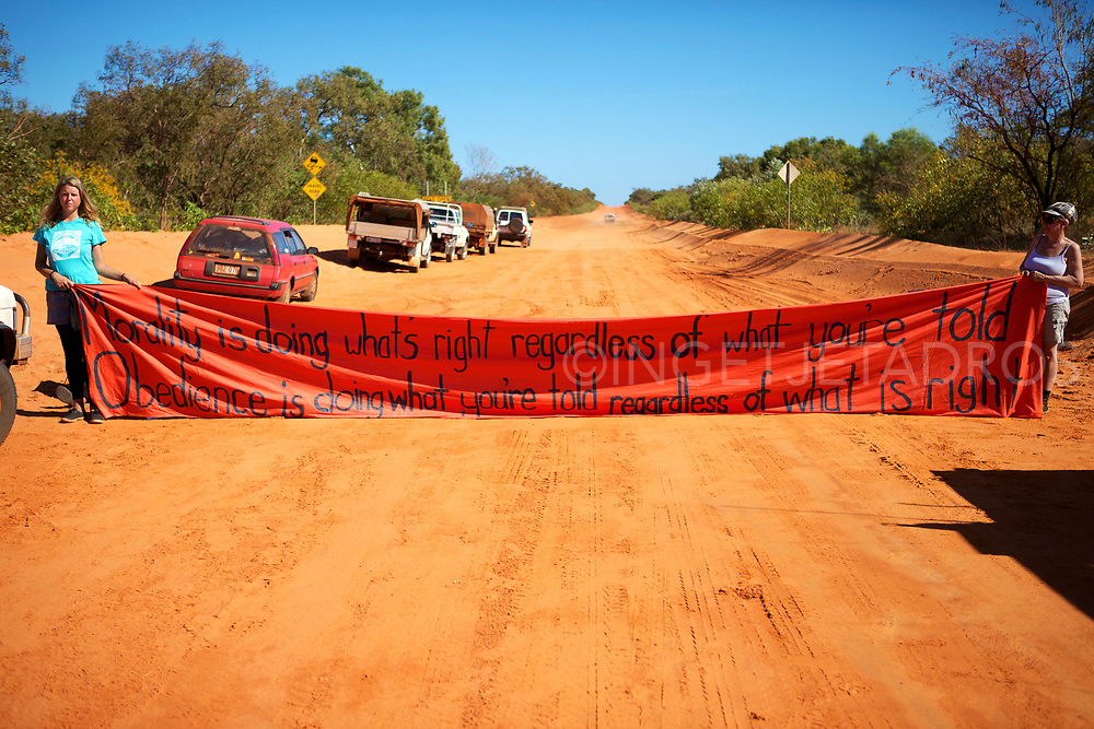 Protesters protesting with a large banner to halt work on Woodside's gas factory project near James Price Point. Broome, WA