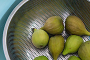 Figs in a strainer about to be rinced.