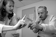 Robert's neurologist gives him an examination at the hospital in March, 2006. Robert was diagnosed with Alzheimer's disease in 2002, and Fabiola cares for her husband of over 60 years alone.