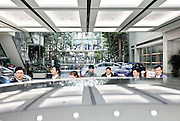 Employees at the showroom of Hyundai Motor Group headquarters. Seoul, Korea. 2012